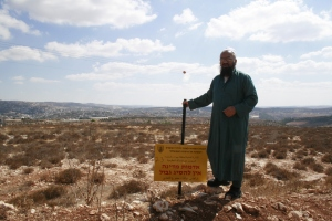 02092014 Sheich nasser next to confiscation sign on his land